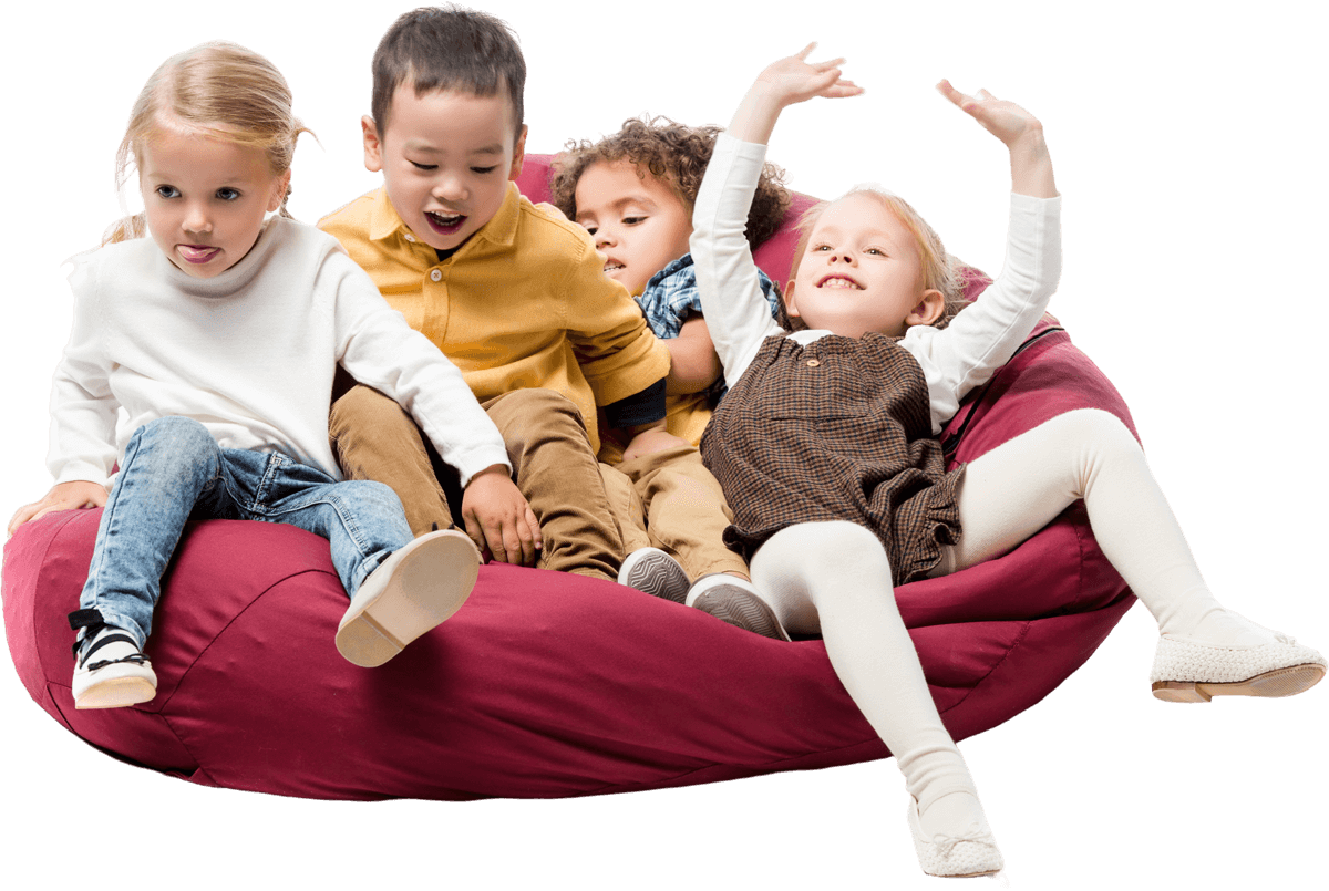 happy children sitting in a bean bag chair